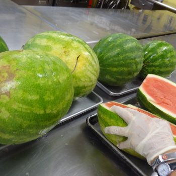 Watermelons being sliced at the Soup Kitchen of Muncie