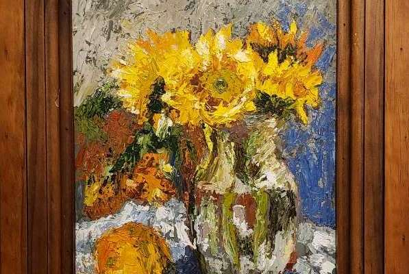An oil painting of sunflowers in a vase